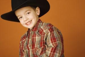 Boy cowboy in black hat