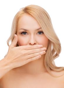 woman hiding her bad breath
