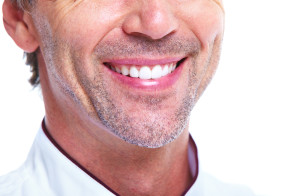 Close Up Shot of Middle Aged Man Who Repaired a Chipped Tooth with Cosmetic Bonding