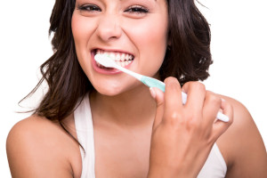 Pretty Brunette Brushes her Teeth to Cavity Proof Her Smile